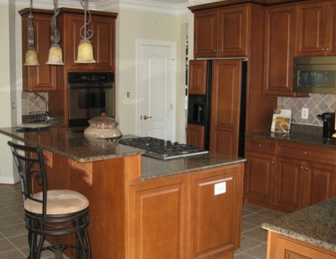 Two-levelled kitchen island with breakfast nook-kitchen_po4_after.jpg