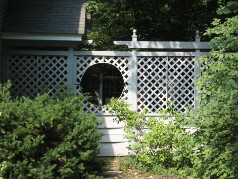 building a fence and gate on existing posts that aren't plumb-lattice-repair-two-tone-fence.jpg