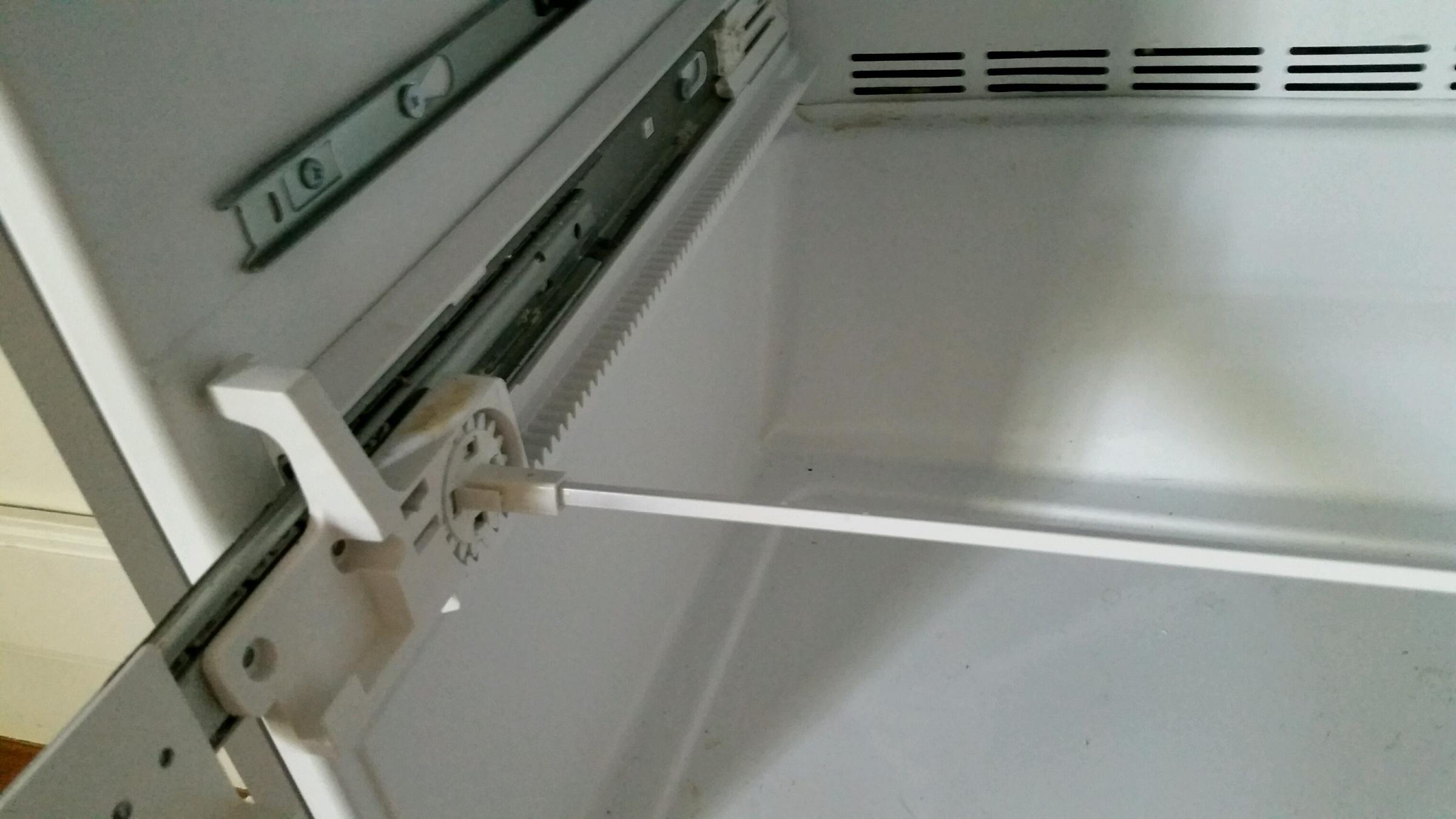 Frigidaire Refrigerator Not Cooling Properly-left-side-bottom-shelf-glide.jpg