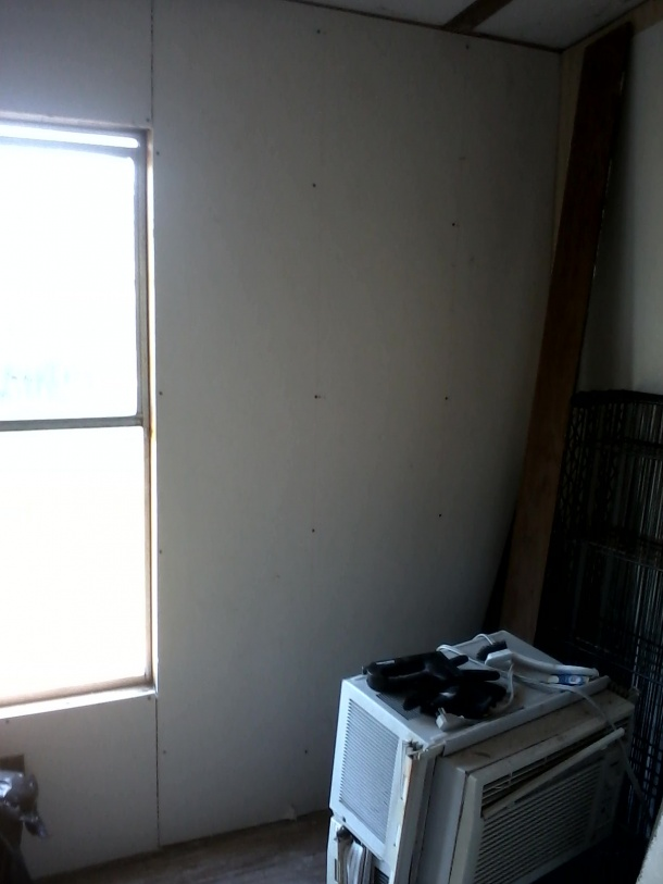 What to use to cover the window framing when drywall wont fit?-living-room-drywall2.jpg