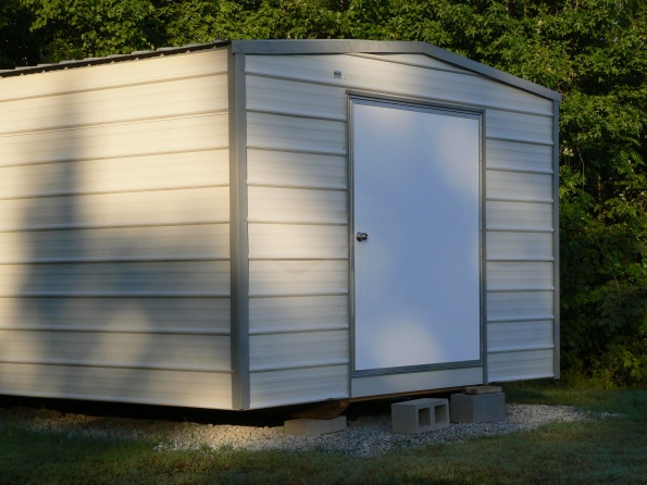 New portable building needs drip cap over the door.-metal-building.jpg