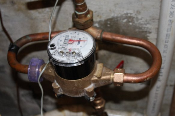 Water meter fitting leaking-meter.jpg