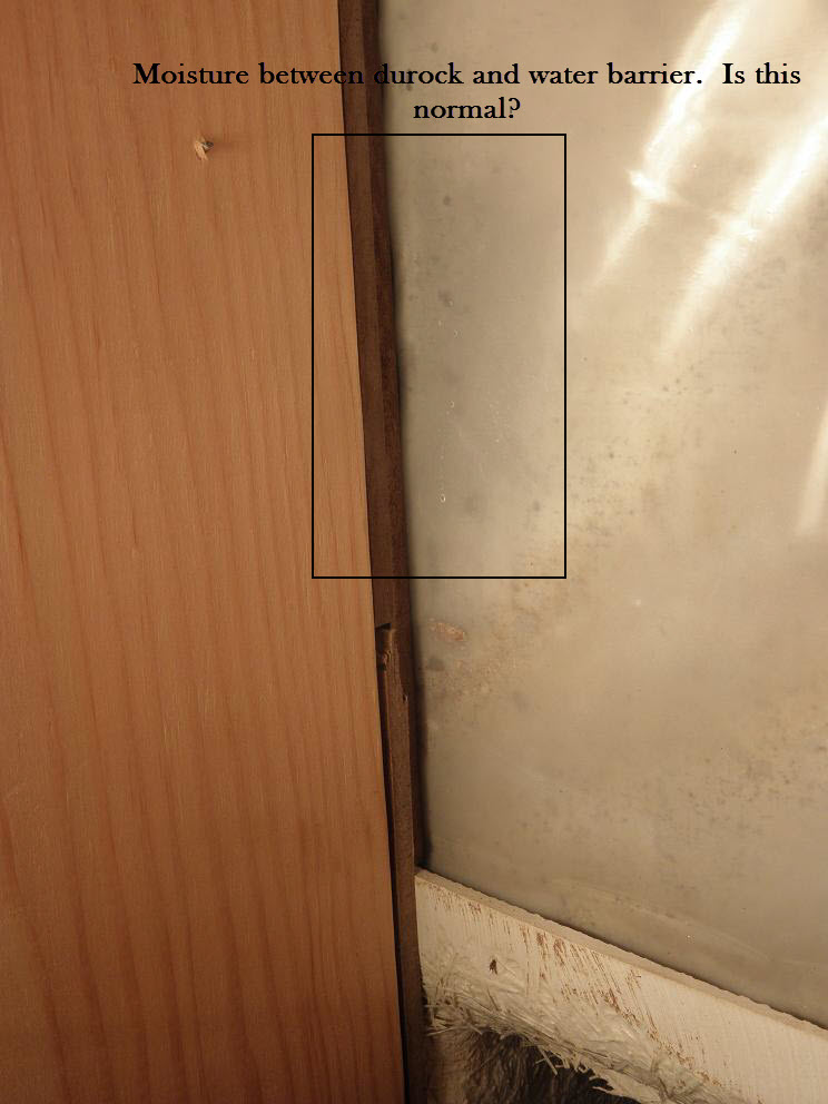 Water issue in bathroom at base of the tub and shower plumbing wall-moisture-between-water-barrier-durock.jpg