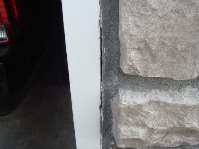Just had new home built need advice please! :)-mortar-gap-missing.-falling-off-garage-right-side.jpg