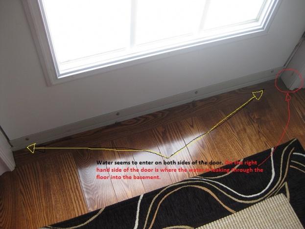 Water leaking in through door on main floor down to basement.-newinsidemain.jpg