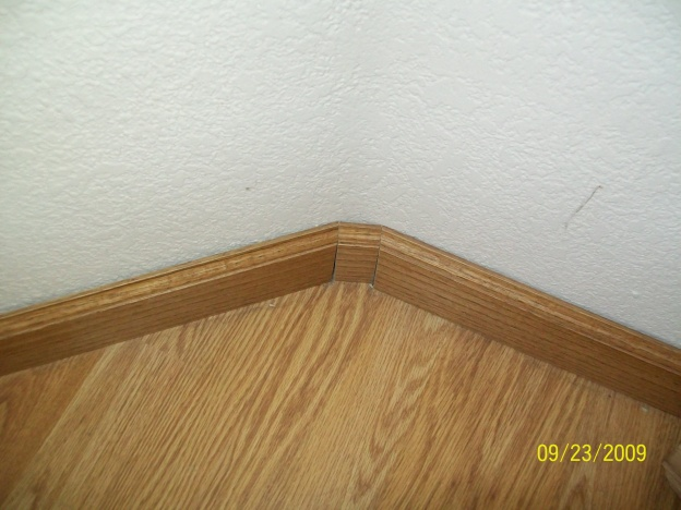 need help understanding what to do. oak baseboards-not-90degree-corner.jpg