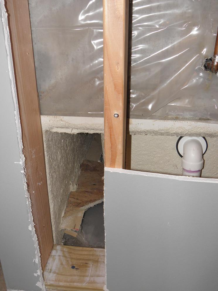 Water issue in bathroom at base of the tub and shower plumbing wall-open-plumbing-wall.jpg