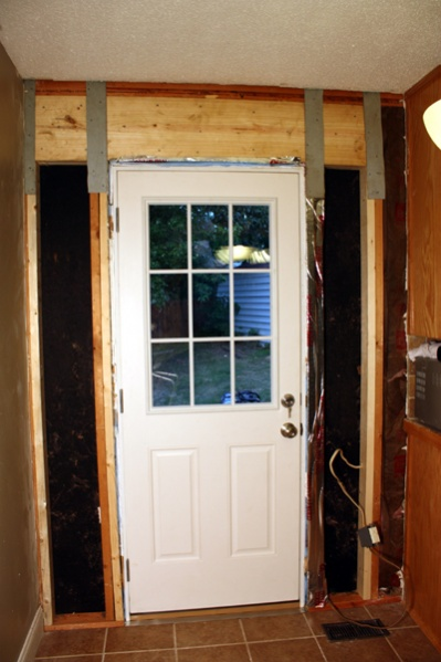 How to handle a cross-brace that is in the way of a new door-openwall-001.jpg
