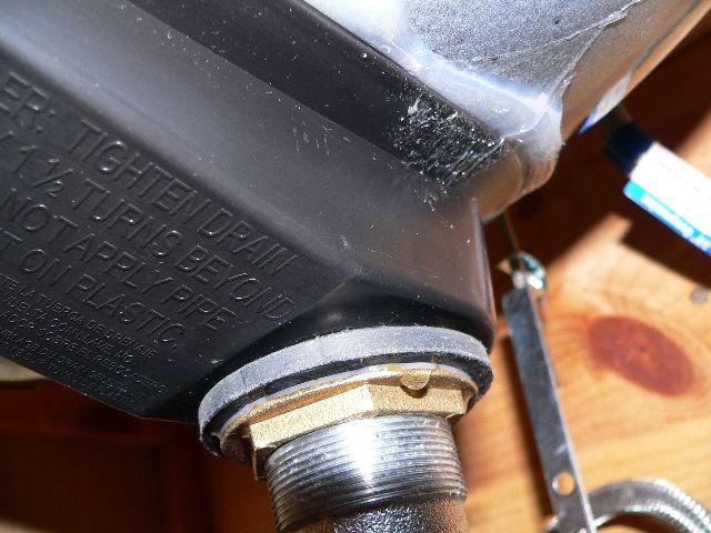 How do you seal plastic overflow drain hole on bathroom sink?-p1000666-s.jpg