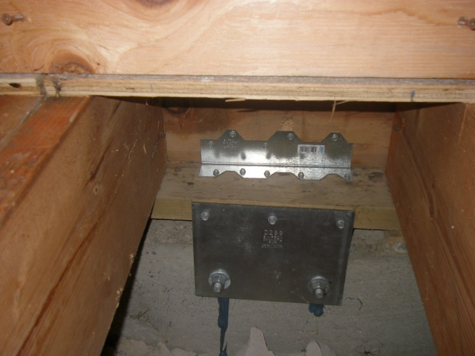 A Simpson StrongTie retrofit hardware working together to resist an earthquake