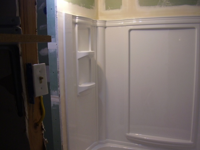 I made a mistake and put in the tub surround early. Need plumbing help!!-p1220057.jpg
