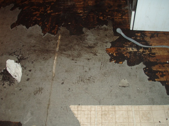 removing old laminate flooring in kitchen concerned about asbestos