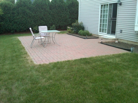 Flagstone between foundation and paver patio-patio.jpg