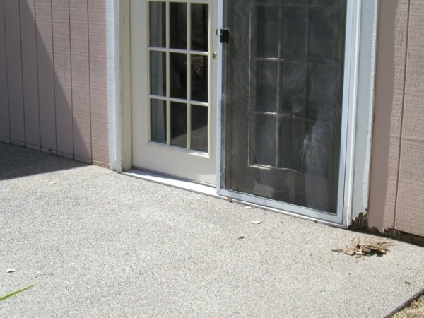 Patio Poured up to the T111 Siding and ROT!-patio2.jpg