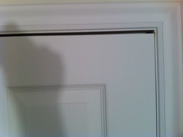 Interior door uneven at the top (door doesn't latch)-photo-1.jpg