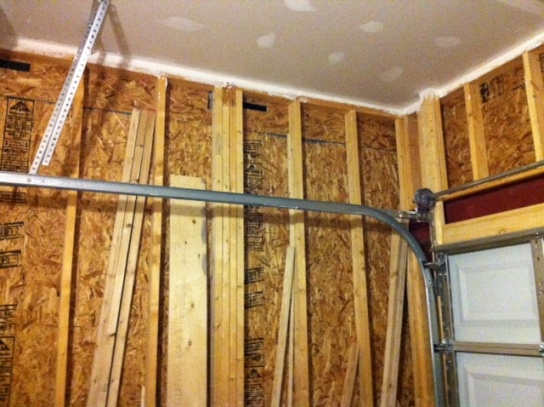 Wholes the builder cut into the inside garage walls?-photo-2.jpg