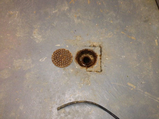sewage smell and and history of backup in floor drains-photo-3.jpg