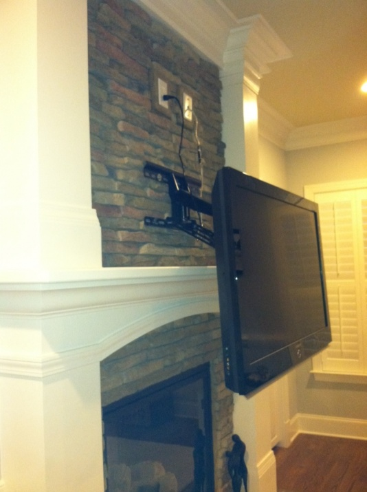 1/2 brick then I would assume drywall Just bought this townhome and we want to put the TV over the fireplace. I