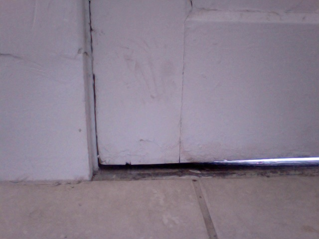 uneven gap at bottom of door-photo-2012-09-18-12.19-2.jpg
