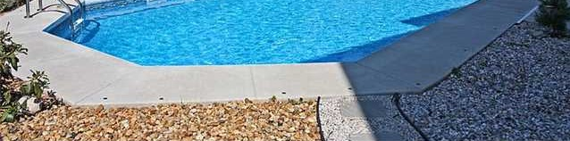 Pavers over rockbed around pool - decent temporary solution?  (pic included)-poolrocks.jpg