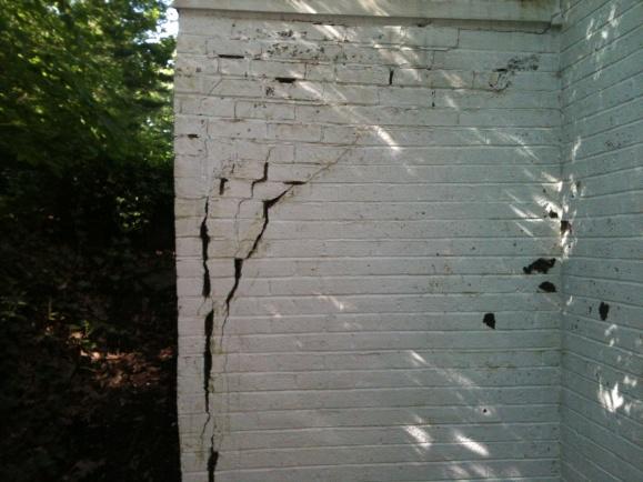 Badly damaged veneer-porch.jpg