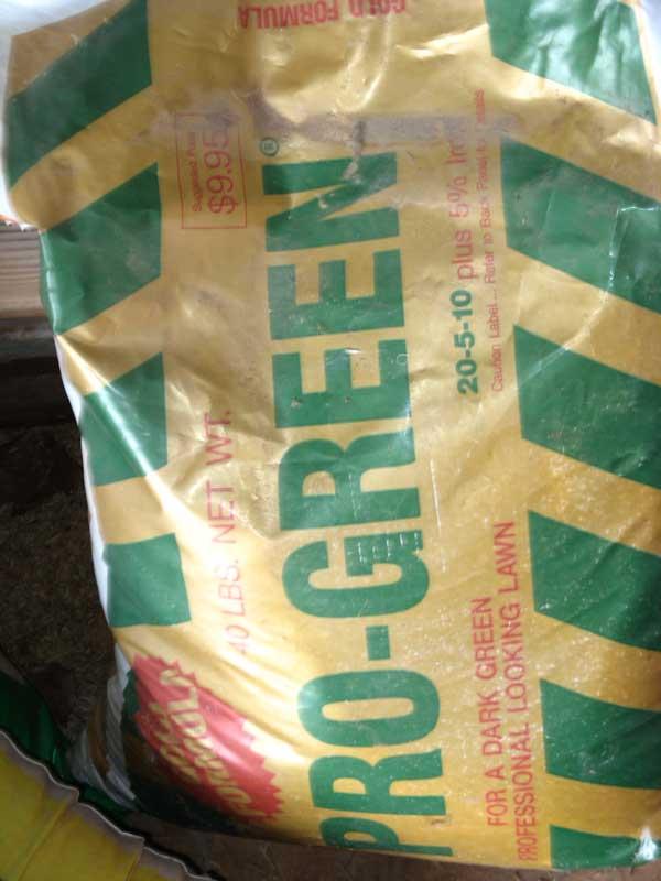 Old homeowner left this fertilizer....Should I use it?-pro-green.jpg