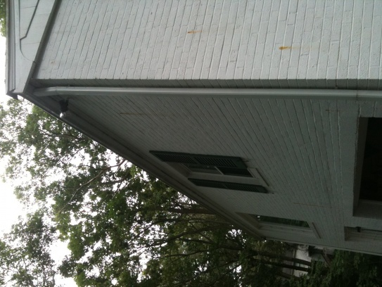 um...orange rust streaks on my exterior walls?-rear-roofline.jpg