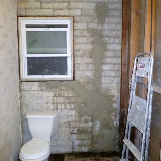 UNlevel now -orig joists with blocking LOW in 1 corner!-resized-patched-plumbing-wall.jpg