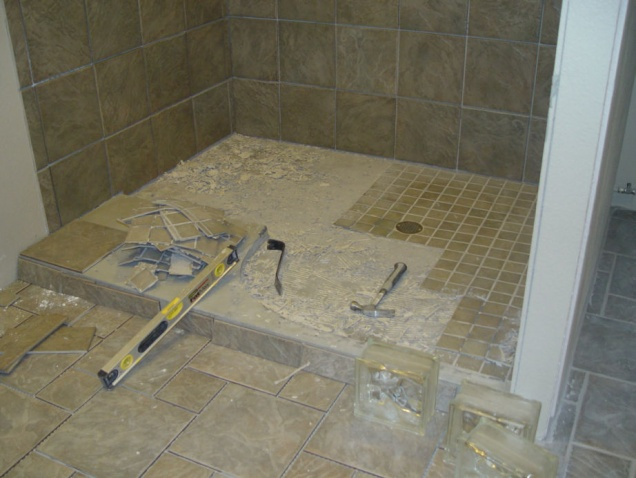 tile man used mastic glue on entrance to shower-ripping-floor-out.jpg