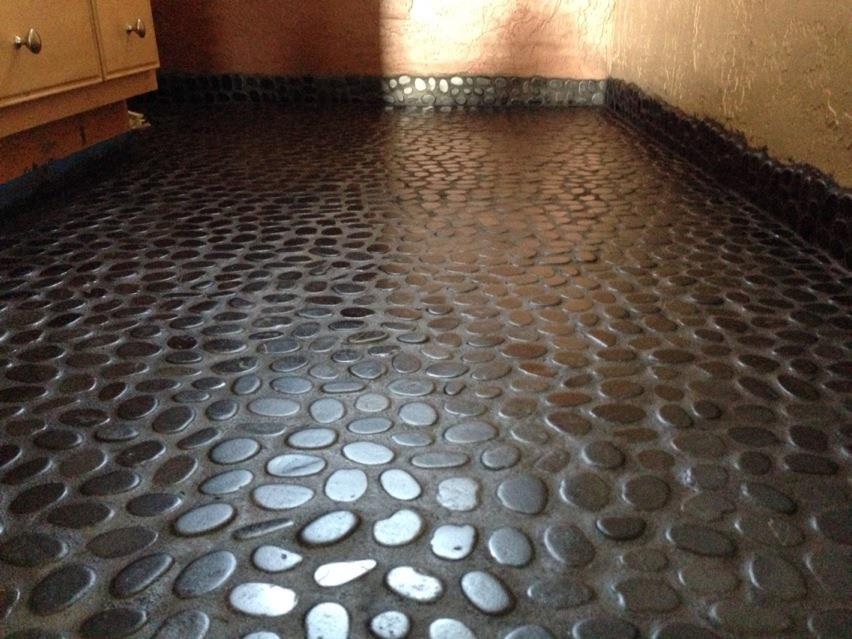 River rock floor in bathroom. Complete-riverrock.jpg