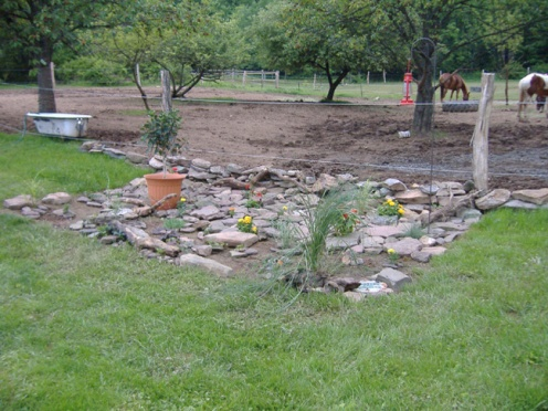 Hard rain creek runs through yard. HELP-rock1.jpg