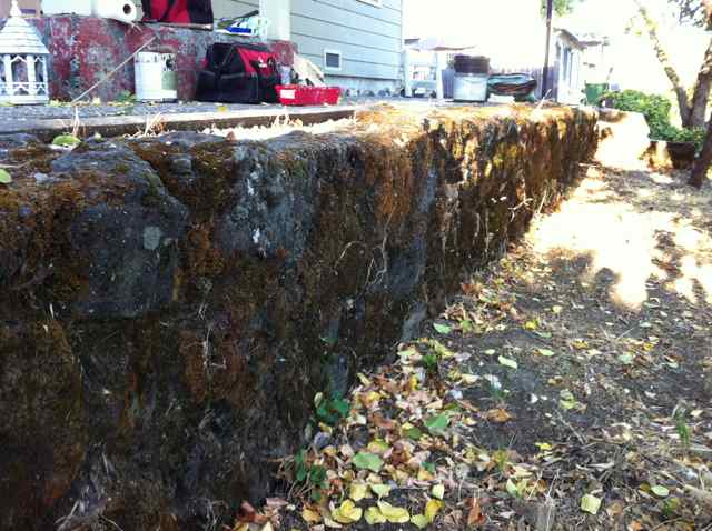 adding rock panels to old stone wall-rockwall.jpg