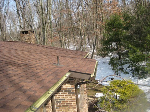 Water leaks into attic and under soffit...-roof-4.jpg