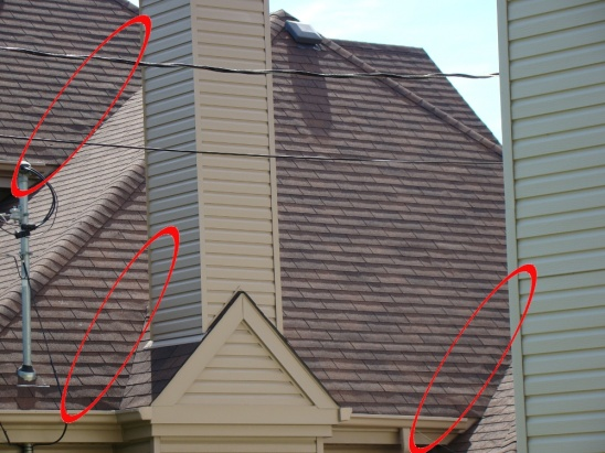 Something pushing up my shingles???-roof.jpg