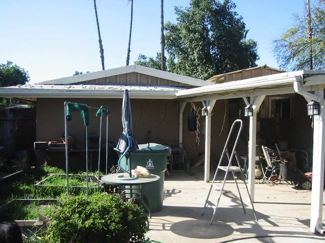 replace tar & gravel roof with shingles & torch down-roof-patio.jpg