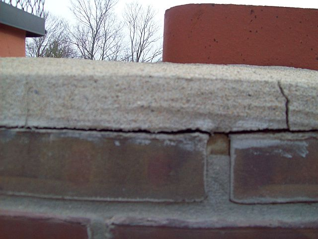 Chimney might have small cracks and is leaking into the house-roof1.b.jpg
