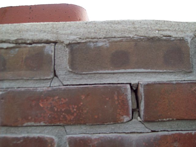 Chimney might have small cracks and is leaking into the house-roof1.jpg