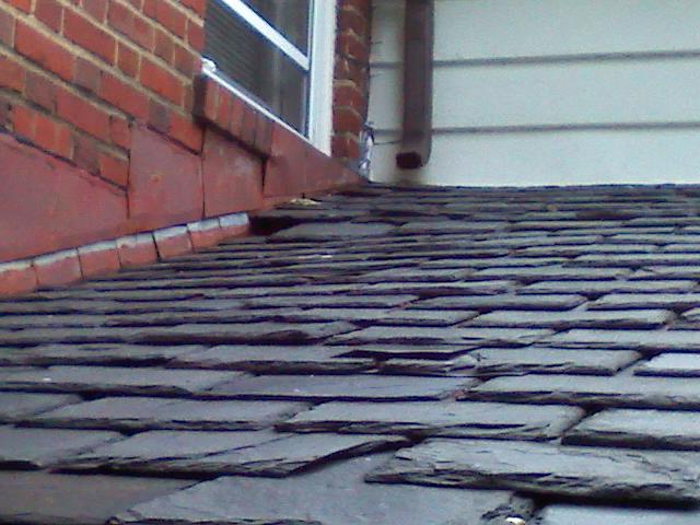 Stucco and Flashing at Base of Chimney Need Repair-sagged-rafters-2-.jpg