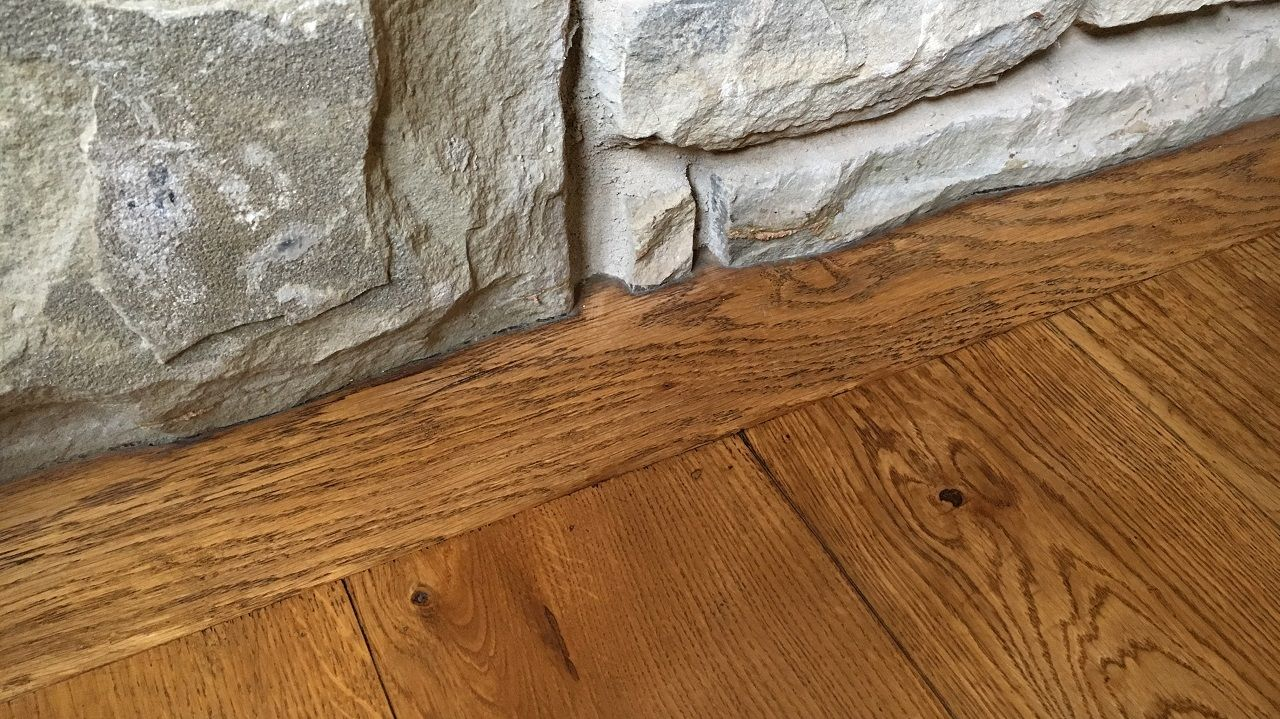 Not sure what to do about stone fireplace - Crown and baseboards.-scribed-flooring.jpg