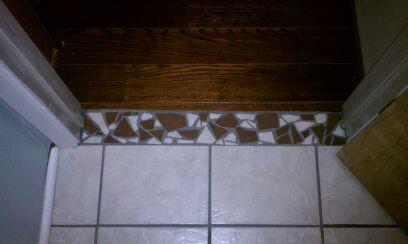 Transition from hardwood to tile-securedownload-4.jpeg