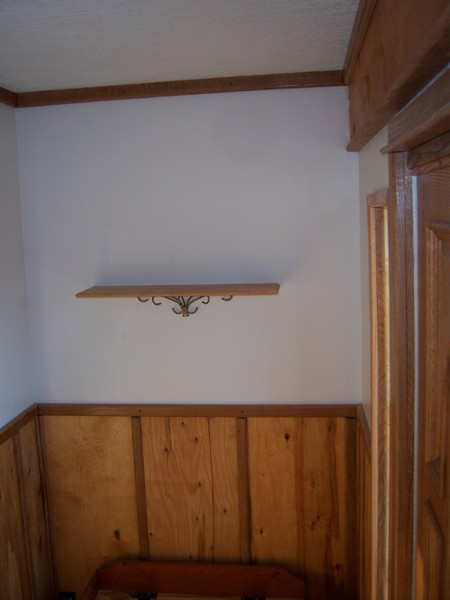 Oak trimming her new foyer.-shelf.jpg