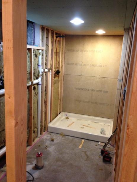 tile floor and acrylic shower-shower.jpg