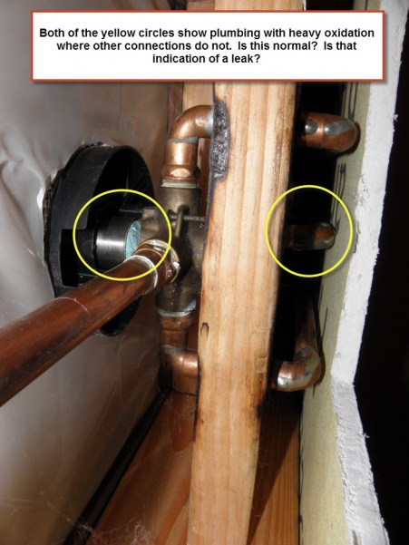 Water issue in bathroom at base of the tub and shower plumbing wall-shower-plumbing-junction.jpg