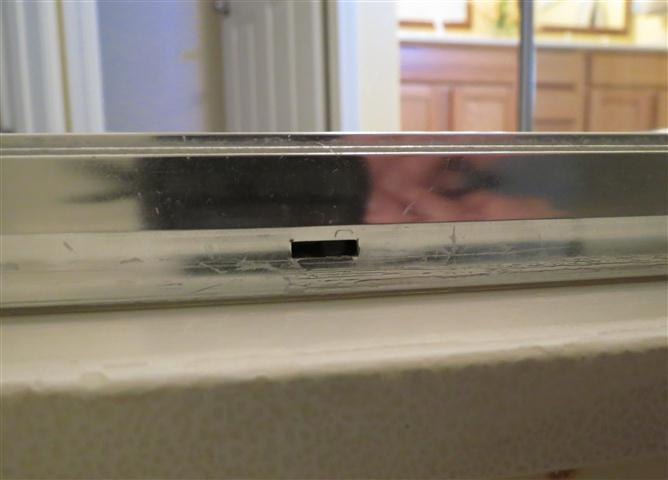 Water pooling on bottom track of sliding door-shower-track.jpg