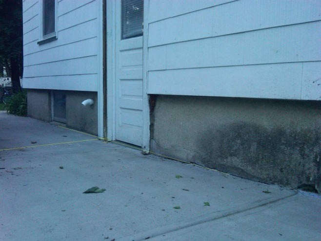 new Concrete Driveway pitched towards house-side-door.jpg