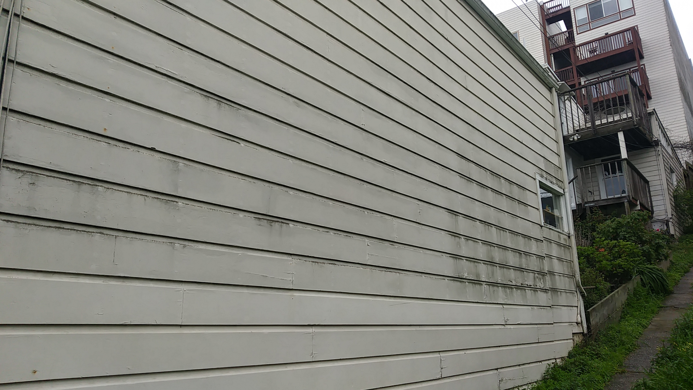 New building will adjoin mine. Should I waterproof my siding?-siding-3.jpg