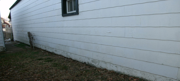 foundation slope-siding-deterioration2.jpg