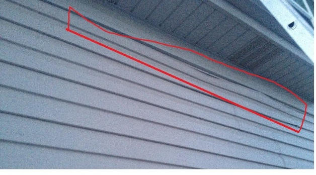 Poor workmanship...How should this vinyl siding have been attached?-siding1.jpg