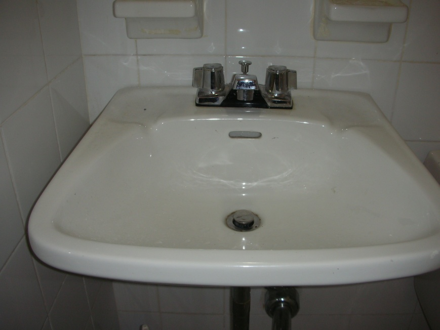 Water leaking on bottom of faucet when turned on-sink.jpg
