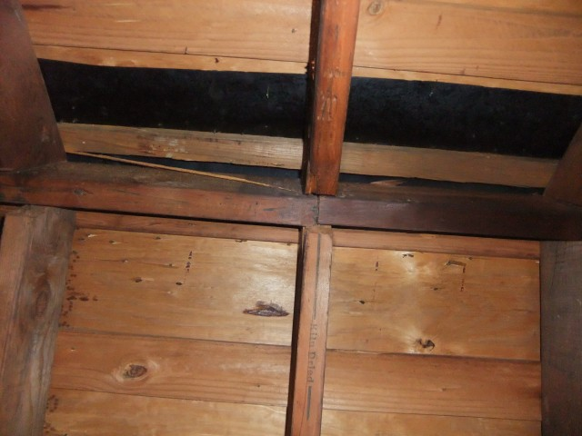 rafters poorly attached to ridge beam-south-attic-roof-beam-001-sm.jpg